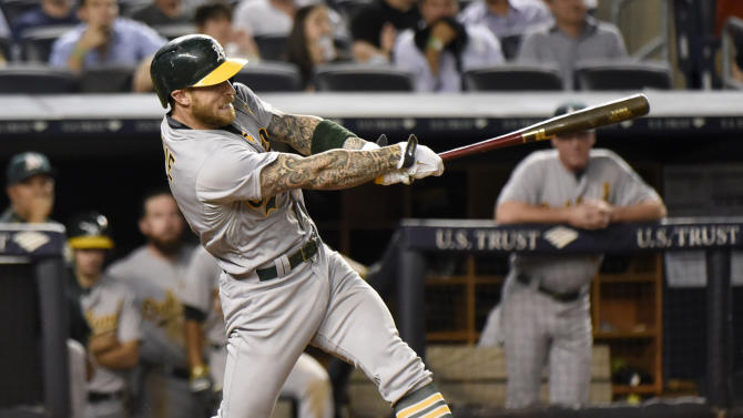 Oakland Athletics' Brett Lawrie hits a home run during the 10th inning of a baseball game against the New York Yankees Tuesday, July 7, 2015, at Yankee Stadium in New York. The Athletics defeated the Yankees 4-3. (AP Photo/Bill Kostroun)