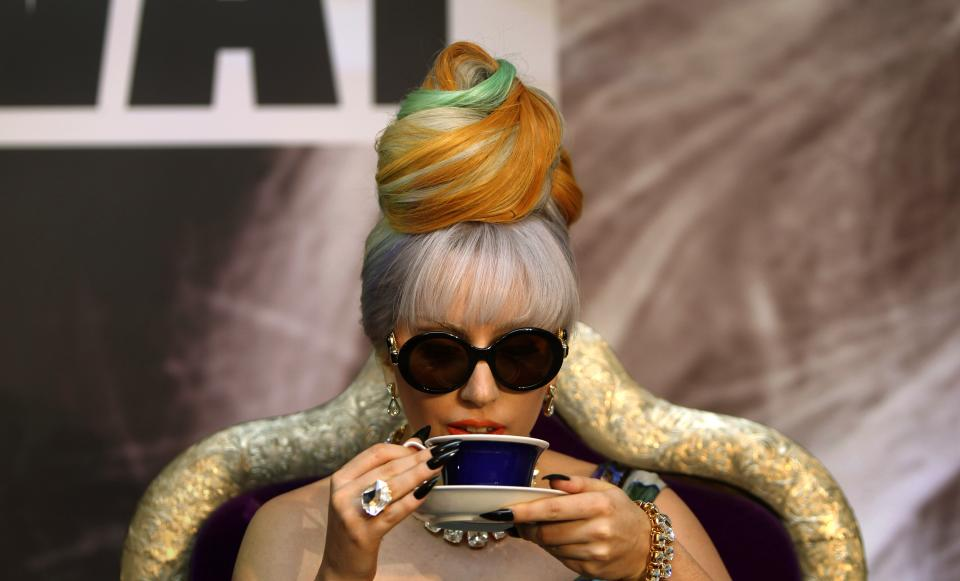 US singer Lady Gaga sips tea during a  press conference in New Delhi, India, Friday, Oct. 28, 2011. (AP Photo/Mustafa Quraishi)