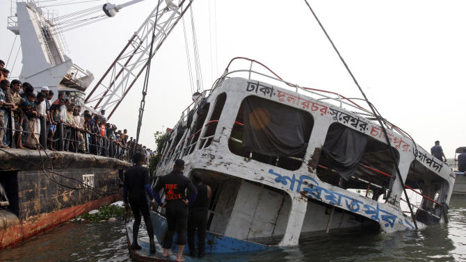 A crane lifts the wreckage of a ferry that capsized in the Meghna River in Munshiganj district, about 32 kilometers (20 miles) south of Dhaka, Bangladesh, Wednesday, March 14, 2012. Recovery workers were trying to raise the wreckage of a ferry that capsized on a river in Bangladesh while carrying about 200 people, hoping Wednesday's efforts would reveal the fate of dozens of passengers still missing. The death toll rose to 110, while dozens of passengers still remain missing. (AP Photo/Pavel Rahman)