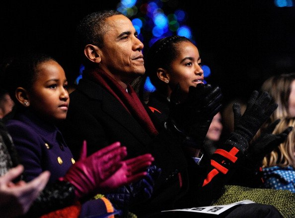 U.S. President Barack Obama and daughters Sasha (L) and Malia participate in the 2011 National Christmas Tree Lighting on December 1, 2011 at the Ellipse, south of the White House, in Washington, DC. 