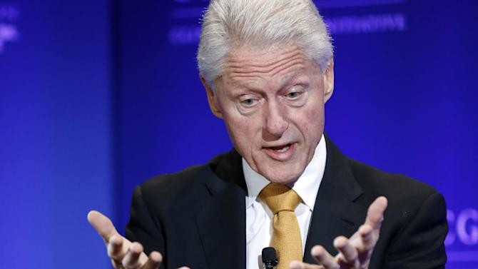 """Former President Bill Clinton gestures during a televised conversation hosted by Bloomberg TV titled """"A New Competitive Era: America in the World,"""" on the final day of the annual gathering of the Clinton Global Initiative America, at the Sheraton Downtown in Denver, Wednesday, June 25, 2014. (Brennan Linsley/AP Photo)"""