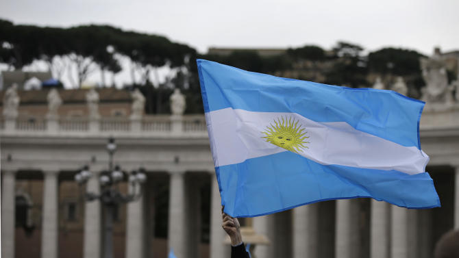 A visitor waves an Argentine flag before the Angelus prayer by Pope Francis in St. Peter's Square at the Vatican, Sunday, March 17, 2013.  (AP Photo/Gregorio Borgia)