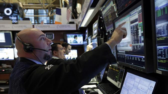 Traders work in their booth on the floor of the New York Stock Exchange Friday, March 8, 2013. Stocks are opening higher on Wall Street after the government reported a burst of hiring last month that sent the unemployment rate to a four-year low. (AP Photo/Richard Drew)