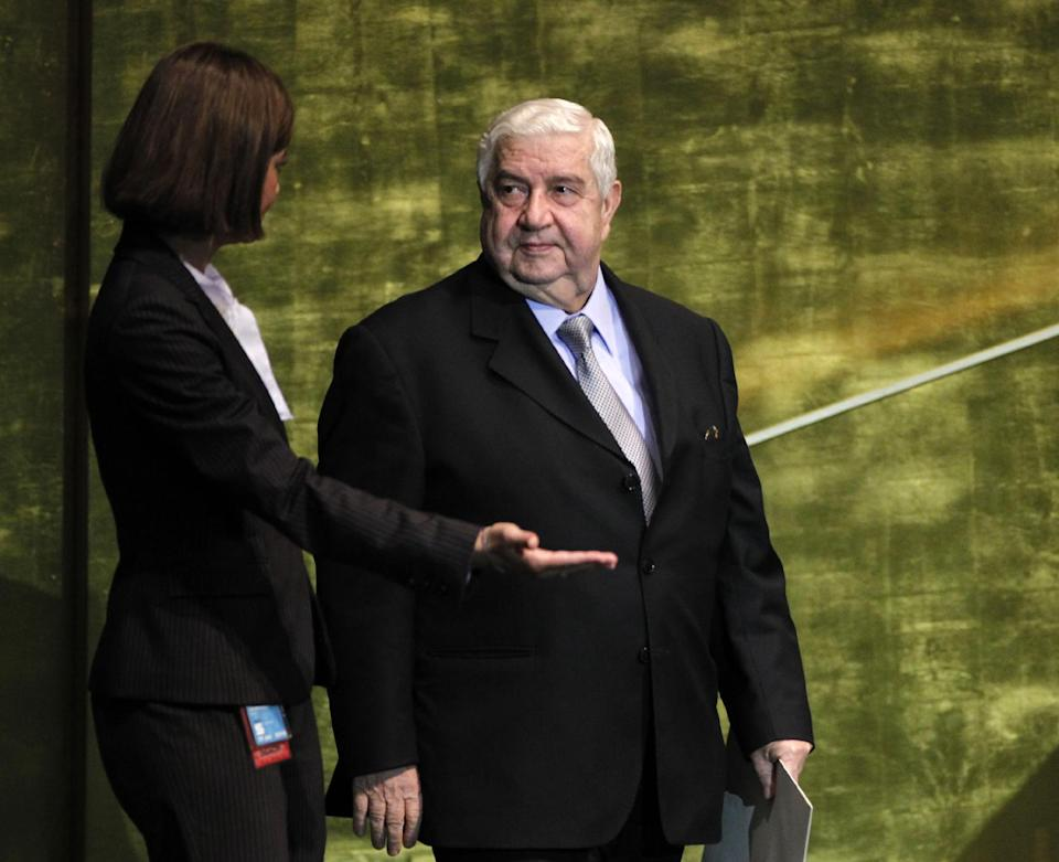 Walid al-Moallem, Foreign Minister of Syria, is guided to the podium before speaking at the 67th session of the United Nations General Assembly at U.N. headquarters, Monday, Oct. 1, 2012. (AP Photo/Jason DeCrow)