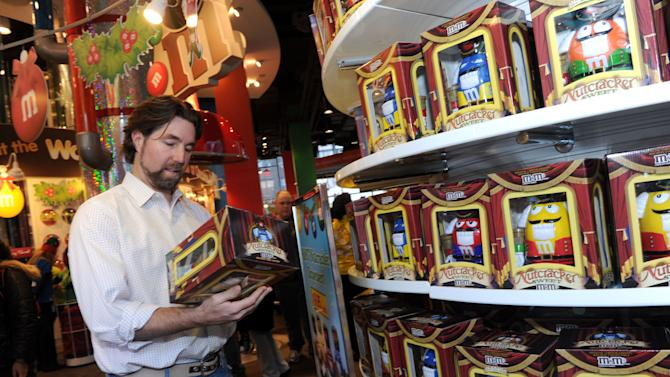 IMAGE DISTRIBUTED FOR M&M's WORLD - Cy Young Award winning pitcher R.A. Dickey checks out holiday-themed merchandise in the new Holiday Village at M&M's World in New York, Tuesday, Dec. 11, 2012.  The new M&M's World Holiday Village offers a variety of seasonal-themed merchandise including dispensers, clothing, ornaments and holiday-themed M&M's Brand Chocolate Candies. (Diane Bondareff/Invision for M&M's World/AP Images)