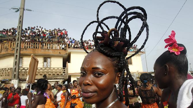 People take part in a parade during the Popo (Mask) Carnival of Bonoua, in the east of Abidjan