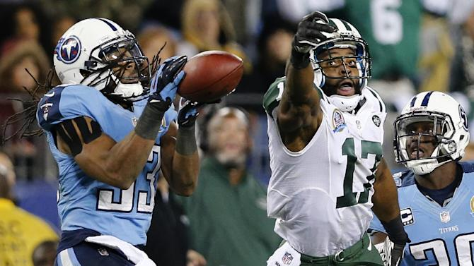 Tennessee Titans safety Michael Griffin (33) intercepts a pass intended for New York Jets wide receiver Braylon Edwards (17) in the fourth quarter of an NFL football game, Monday, Dec. 17, 2012, in Nashville, Tenn. The Titans won 14-10. At right is Titans cornerback Jason McCourty (30). (AP Photo/Joe Howell)