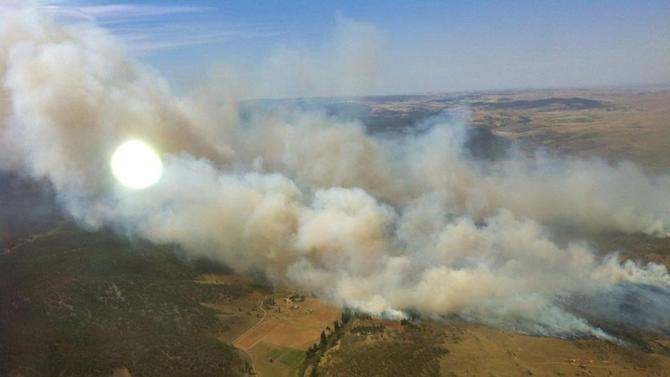 In this photo provided by the New South Wales Rural Fire Service, plumes of smoke rise from a fire near Cooma, Australia, Tuesday, Jan. 8, 2013. Temperatures across much of New South Wales state are expected to reach 45 degrees Celsius (113 degrees Fahrenheit) causing extreme conditions. (AP Photo/New South Wales Rural Fire Service) EDITORIAL USE ONLY