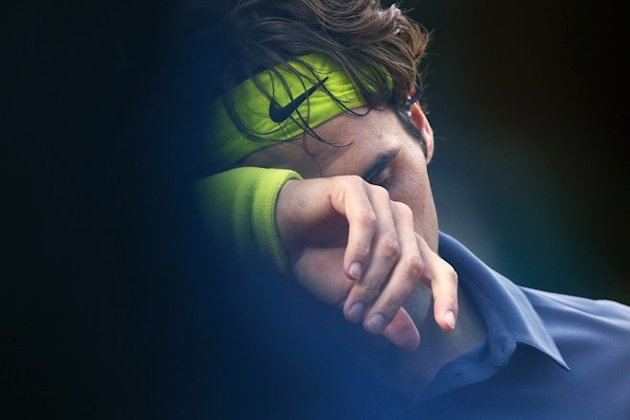 TOPSHOTS Switzerland's Roger Federer Reacts As He Plays With Serbia's Novak Djokovic  AFP/Getty Images