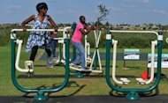 People work out at new outdoor gym in Soweto on March 19, 2012