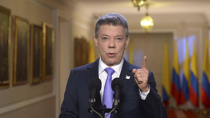 Colombia's President Juan Manuel Santos speaks during a TV speech to the country at presidential palace in Bogota