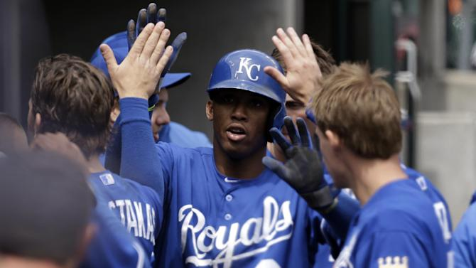 Kansas City Royals' Alcides Escobar celebrates scoring on a Billy Butler single against the Detroit Tigers in the third inning of a baseball game in Detroit, Thursday April 25, 2013. (AP Photo/Paul Sancya)