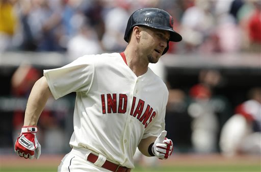 Cleveland Indians' Ryan Raburn runs the bases after hitting a three-run home run off Seattle Mariners starting pitcher Hisashi Iwakuma in the second inning of a baseball game, Monday, May 20, 2013, in