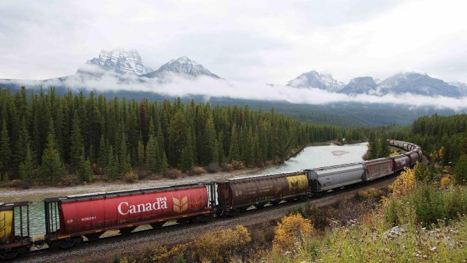 File photo of rail cars loaded with Canadian wheat in the Rocky Mountains on the Canadian Pacific railway line near Banff, Alberta