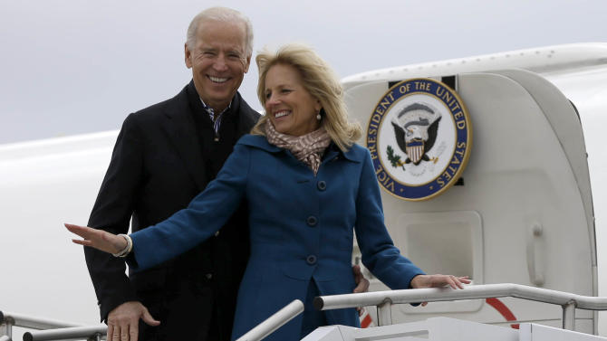 Vice President Joe Biden, accompanied by his wife Jill Biden, board Air Force Two, Tuesday, Nov. 6, 2012, at a Delaware Air National Guard Base in New Castle , Del., en route to Chicago.  (AP Photo/Matt Rourke)