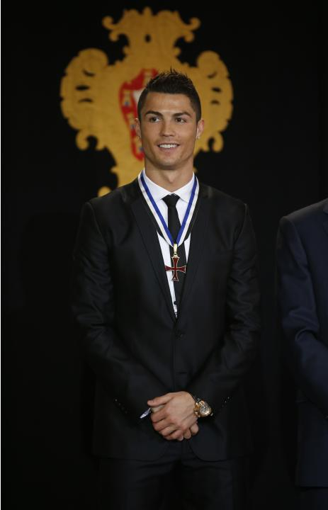 Portugal's soccer team captain Ronaldo poses after receiving the Ordem do Infante Dom Henrique in Lisbon