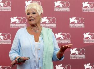 "Actress Dench poses during a photocall for the movie ""Philomena"", directed by Stephen Frears, during the 70th Venice Film Festival in Venice"