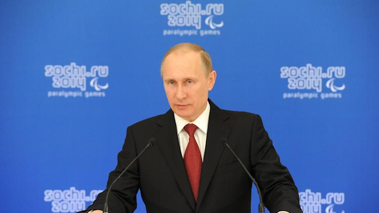 Russian President Vladimir Putin addresses a meeting with heads of national paralympic committees in Sochi, Russia, Thursday, March 13, 2014. (AP Photo/RIA Novosti Kremlin, Mikhail Klimentyev, Presidential Press Service)