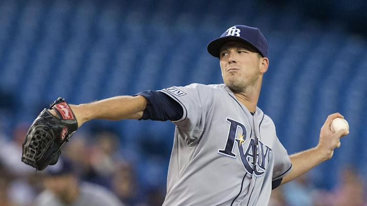 Tampa Bay Rays starting pitcher Drew Smyly works against Toronto Blue Jays during the fourth inning of a baseball game, Friday, Aug. 22, 2014 in Toronto. (AP Photo/The Canadian Press, Chris Young)