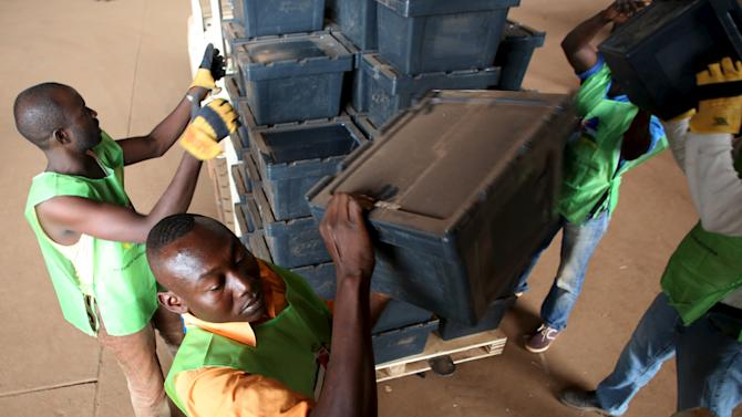 Workers load a United Nations truck with electoral equipment destined for polling stations in the capital in Bangui