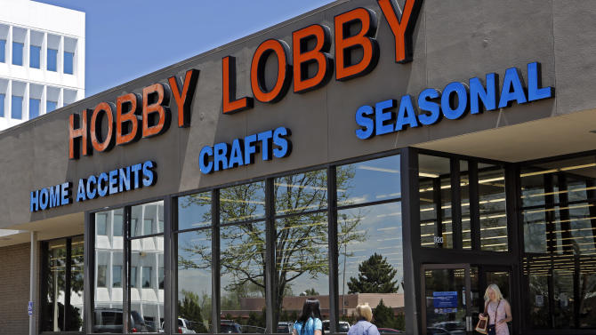 FILE - In this May 22, 2013, customers enter and exit a Hobby Lobby store in Denver. A federal appeals court on Thursday, June 27, 2013 ruled that Hobby Lobby stores have a good case that the federal health care law violates their religious beliefs in ordering them to provide birth control to employees, and that they shouldn't be subject to millions in fines while their claim is considered. (AP Photo/Ed Andrieski, File)