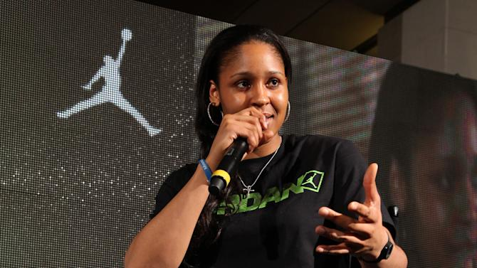 Jordan Brand athlete, Maya Moore, answers questions at Jordan Brand's Flight Experience on Saturday, February 16, 2013 in Houston, TX. The former UConn alum will debut a Aero Mania PE in a green colorway, symbolic of the green ribbons honoring the victims of Newtown, Conn. (Photo by Omar Vega/Invision for Jordan Brand/AP Images)
