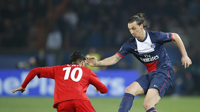 PSG's Zlatan Ibrahimovic, right, vies for the ball with Leverkusen's Emre Can during a Champions League last 16 second leg soccer match between Paris Saint Germain and Bayer Leverkusen at Parc des Princes stadium in Paris, Wednesday, March 12, 2014