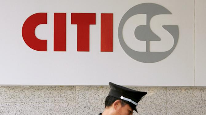 File photo of a security guard under the logo of CITIC Securities at a branch of the security brokerage house in Shanghai