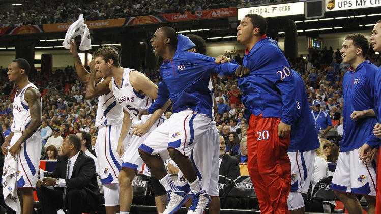 The Kansas  bench reacts after a basket in the first half of an NCAA college basketball game against the Michigan  State in Atlanta, Tuesday, Nov. 13, 2012. (AP Photo/John Bazemore)