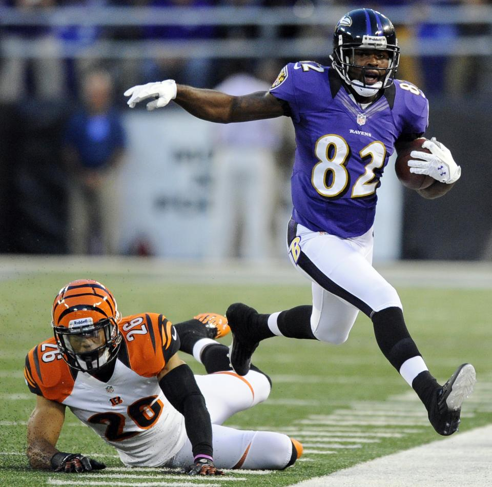 Baltimore Ravens wide receiver Torrey Smith (82) is chased out of bounds by Cincinnati Bengals safety Taylor Mays in the first half of an NFL football game in Baltimore, Monday, Sept. 10, 2012. (AP Photo/Nick Wass)
