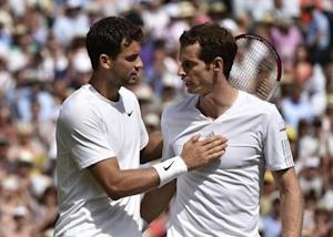 Grigor Dimitrov of Bulgaria speaks to Andy Murray of Britain after defeating him in their men's singles quarter-final tennis match at the Wimbledon Tennis Championships, in London