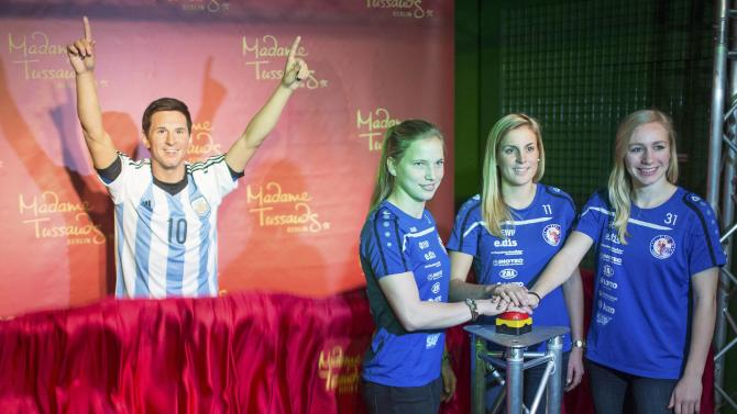 Soccer players Bremer, Kemme and Cramer of the German national soccer team pose with the new wax figure of soccer player Messi at Madame Tussaud's wax figure museum in Berlin