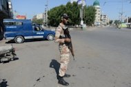 A Pakistani soldier stands guard on a street in Karachi on February 8, 2013. At least ten people were killed and another 26 wounded when a bomb exploded near a shop selling DVDs and mobile phones in Pakistan's northwestern tribal belt