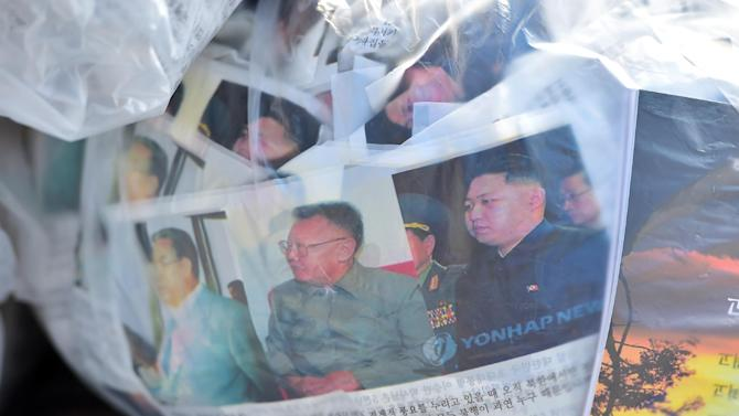 Anti-North Korean leaflets showing pictures of Kim Jong-Il (C) and Kim Jong-Un (R) in balloons being released from Paju in South Korea, October 10, 2014