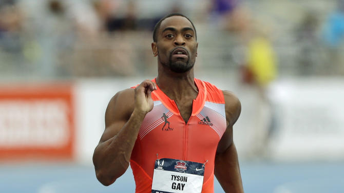 FILE - In this June 23, 2013, file photo, Tyson Gay runs to the finish line to win the senior men's 200-meter dash final at the U.S. Championships athletics meet in Des Moines, Iowa. Gay failed more than one drug test this year, recording one of his positives at the U.S. championships, where he won the 100 and 200 meters in June, The Associated Press learned on Friday, July 26, 2013. (AP Photo/Charlie Neibergall, File)