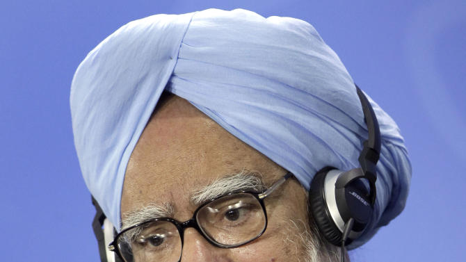 The Prime Minister of India, Manmohan Singh, speaks during a joint press conference with German Chancellor Angela Merkel, unseen, as part of a meeting at the chancellery in Berlin, Germany, Thursday, April 11, 2013. (AP Photo/Michael Sohn)