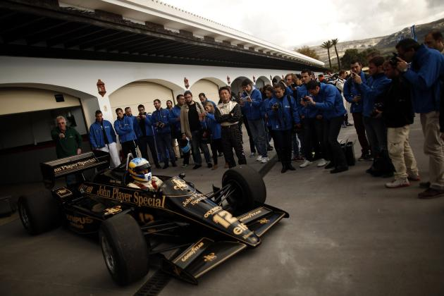 "Yamauchi of Japan stands next to a John Player Special - Lotus 98t during the international presentation of the new Sony PlayStation ""Gran Turismo 6"" video game, in Ronda"