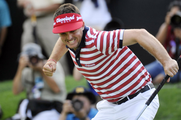 Keegan Bradley celebrates making a par putt on the 18th hole to win the Bridgestone Invitational golf tournament at Firestone Country Club in Akron, Ohio, Sunday, Aug. 5, 2012. (AP Photo/Phil Long)