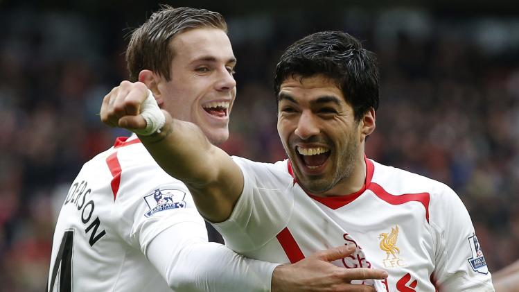 Liverpool's Suarez celebrates his goal against Manchester United with Henderson during their English Premier League soccer match in Manchester