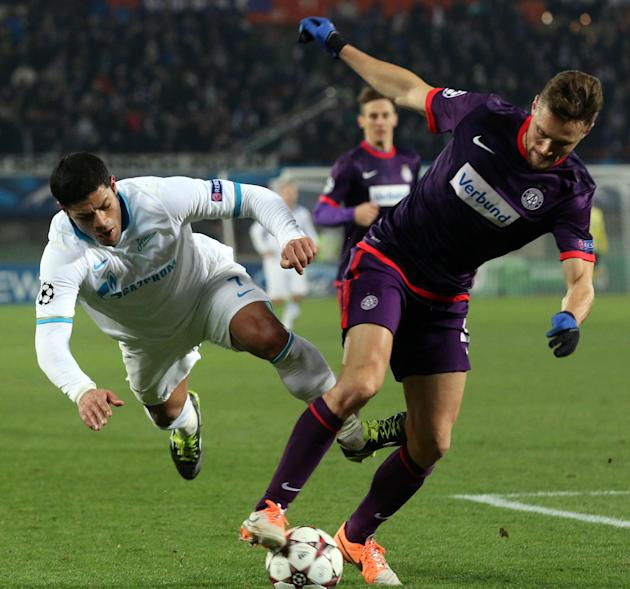 Austria's James Holland, right, and St. Petersburg's Hulk, left, challenge for the ball during the Champions League Group G soccer match between Austria Vienna and Zenit St. Petersburg in Vien