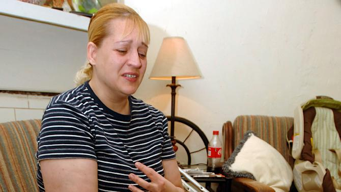 Sherry West talks Friday March 22, 2013, about being shot in the leg Thursday, Mar. 21, 2013 as she pushed her baby in his stroller in Brunswick, Ga., by a young teen who then shot and killed her 13-month-old son Antonio.  (AP Photo/Florida Times-Union, Terry Dickson)
