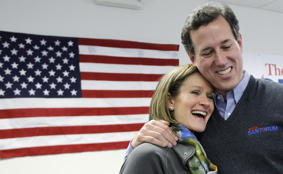 Republican presidential candidate, former Pennsylvania Sen. Rick Santorum hugs his wife, Karen during a stop at his campaign field office, Tuesday, Feb. 28, 2012, in Grands Rapids, Mich.  (AP Photo/Eric Gay)
