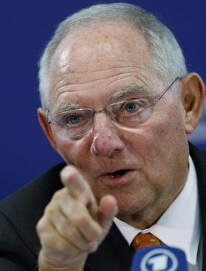 Germany's Minister of Finance Wolfgang Schauble answers questions during a news conference of the Informal Meeting of Ministers for Economic and Financial Affairs (ECOFIN) in the National Art Gallery in Vilnius, Lithuania, Saturday, Sept. 14, 2013. (AP Photo/Mindaugas Kulbis)