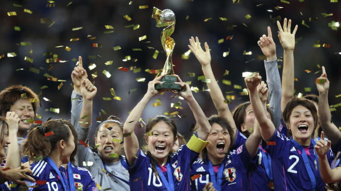 Japan players celebrate with the trophy after winning the final match between Japan and the United States at the Women's Soccer World Cup in Frankfurt, Germany, Sunday, July 17, 2011. The Japanese women's soccer team won their first World Cup Sunday after defeating USA in a penalty shoot-out.(AP Photo/Michael Probst)