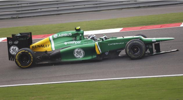 Caterham Formula One driver van der Garde drives with front end damage during the Indian F1 Grand Prix at the Buddh International Circuit in Greater Noida