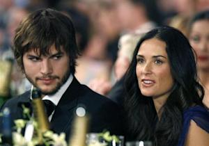 Actor Ashton Kutcher sits with wife actress Demi Moore at the 13th Annual Screen Actors Guild Awards in Los Angeles