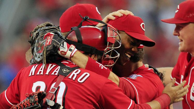 Cincinnati Reds players mob relief pitcher Aroldis Chapman, center, after they defeated the Los Angeles Dodgers 6-0 to clinch the National League Central Division in a baseball game on Saturday, Sept. 22, 2012, in Cincinnati. (AP Photo/Al Behrman)