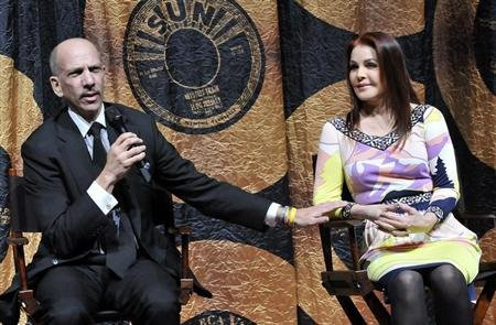 Robert F.X. Sillerman, CEO and chairman of CKX Inc. (L), thanks Priscilla Presley for her participation during a news conference for Cirque du Soleil's new show 'Viva Elvis' inside the Aria Resort & Casino in Las Vegas, Nevada on December 15, 2009. REUTERS/David Becker