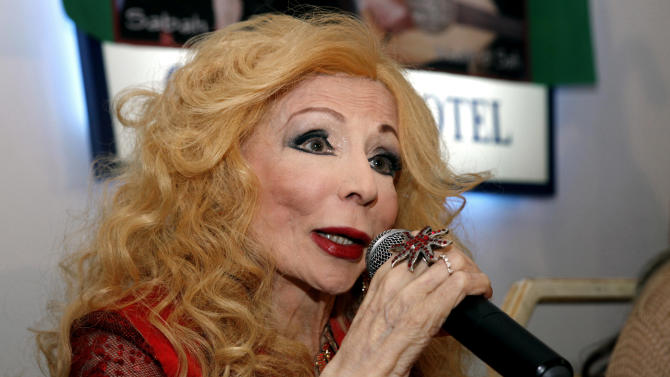 In this Nov. 2011 photo, famous Lebanese singer Sabah speaks to journalists during her birthday in Beirut, Lebanon. Lebanon's official news agency says beloved Lebanese singer and entertainer Sabah has died at the age of 87. (AP Photo/Ahmad Omar)