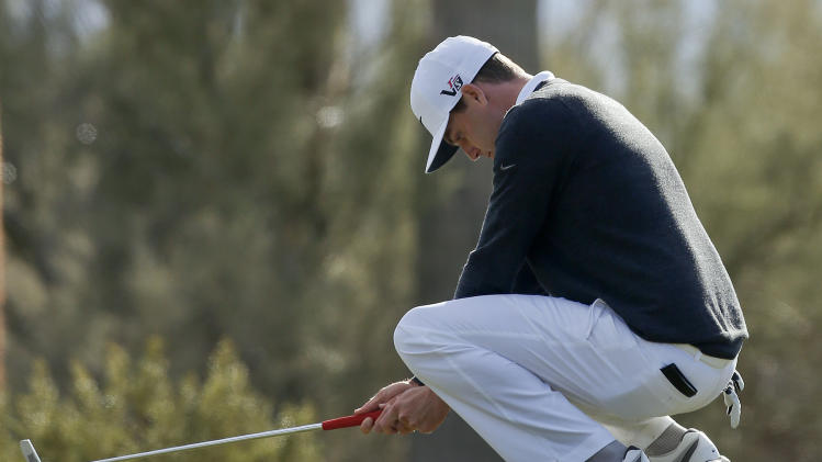 Nick Watney reacts after missing a putt on the second green in the second round of play against Steve Stricker during the Match Play Championship golf tournament, Friday, Feb. 22, 2013, in Marana, Ariz. Stricker won 1 up in 21 holes. (AP Photo/Ross D. Franklin)